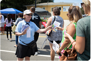 Volunteer Handing Out Maps