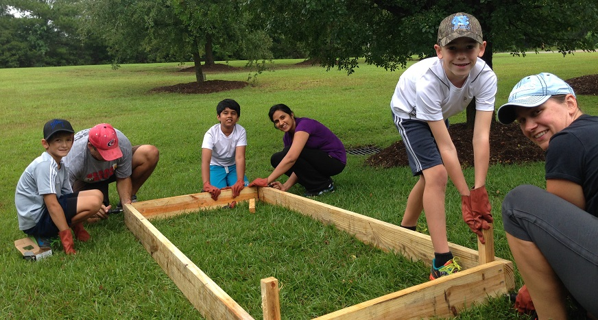 Kids building a raised flower bed