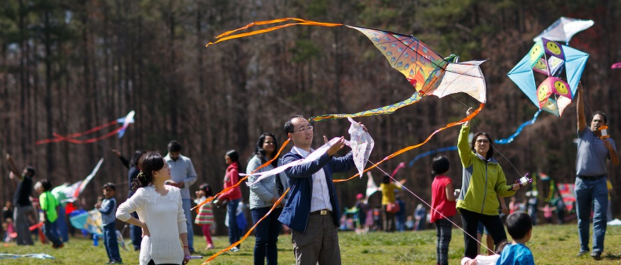 Participants flying kites at the Kite Festival