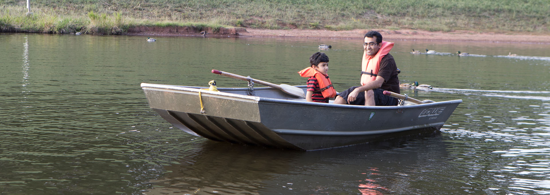 Father and child in a fishing boat