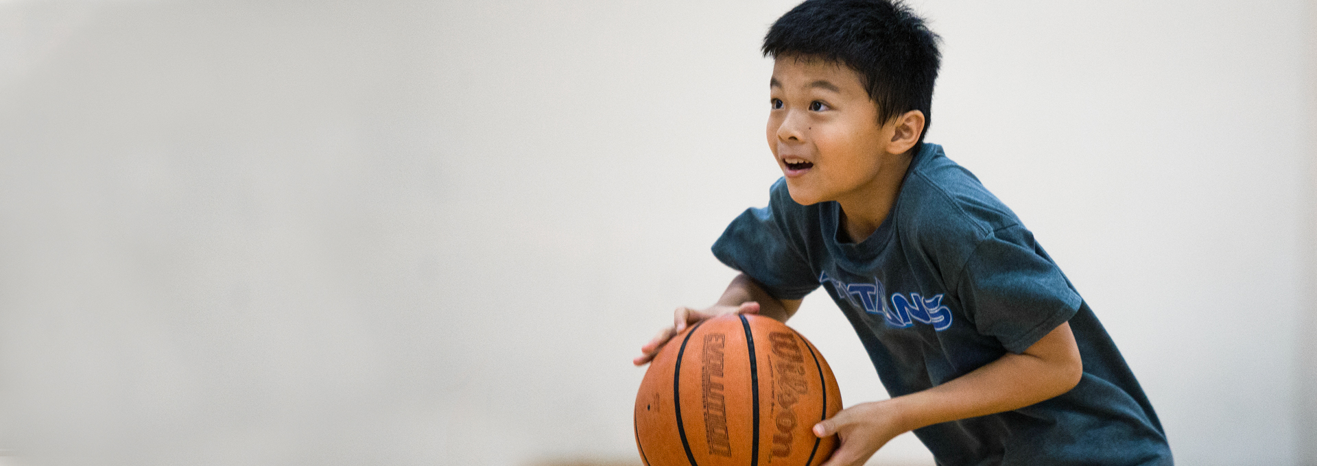 Child shooting basketball