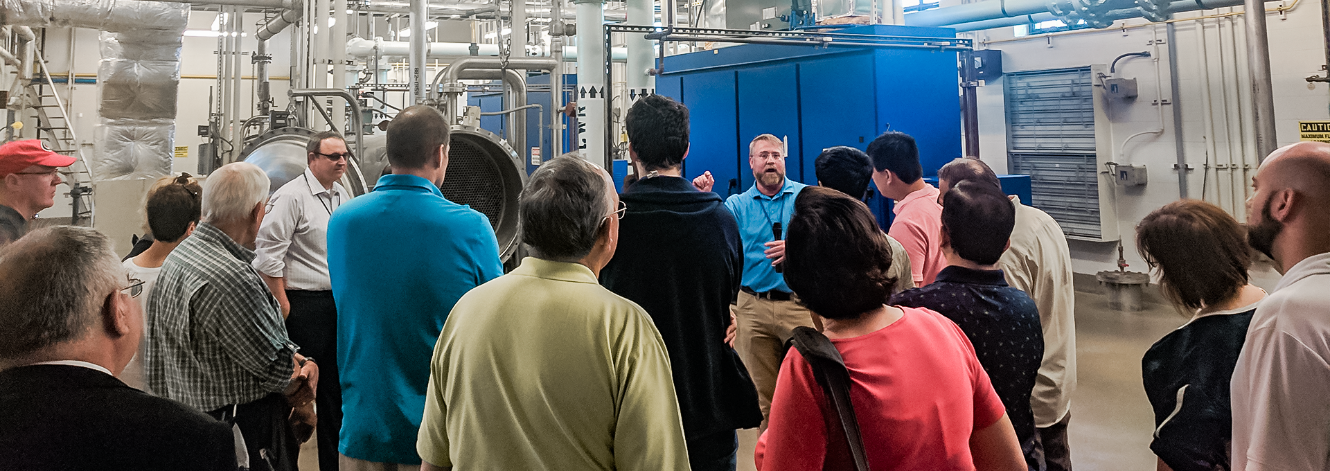 Town staffer giving a tour of a water treatment facility