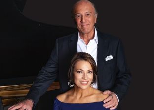 emile and dana seated at a piano