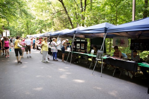 A line of booths at Cultural Arts Row